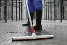 A factory floor being cleaned