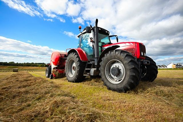 tractor mowing grass in paddock