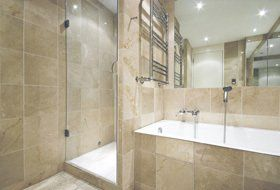 bathroom with glass fronted shower