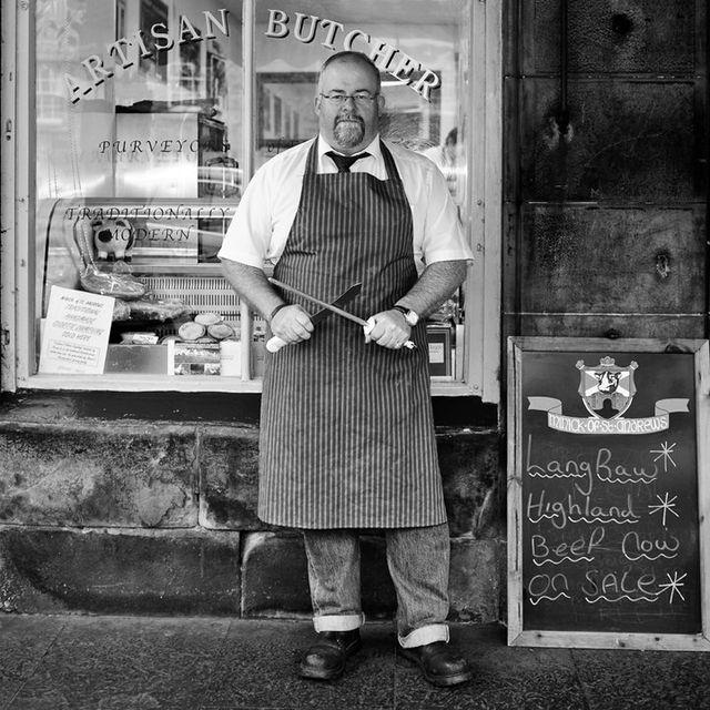 Butcher infront of the Butcher Shop