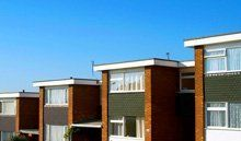 A row of buildings with flat roofs