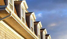 A row of homes with roof windows