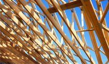 Timber roof beams on an unfinished roof