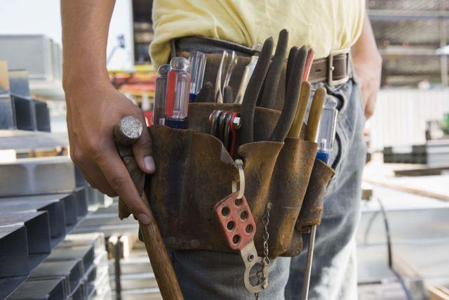 a tradesman wearing his tools Tauranga and surrounds