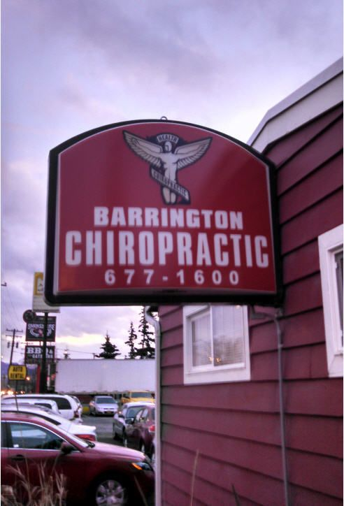 Woman laying on table during treatment by chiropractors in Anchorage, AK