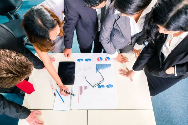 Professionals getting advice on group health plans