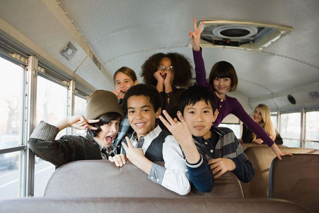 A group of children on a mini bus