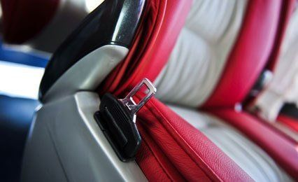 Close view of a grey and red minibus seat