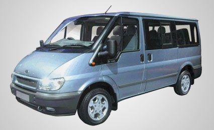 A metallic blue mini bus