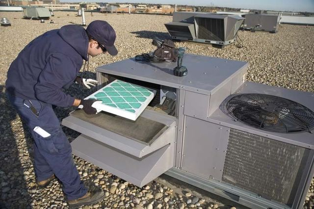 Professional repairing a heating system