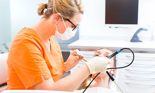 Dentist cleaning a patient's teeth in Jacksonville, AR