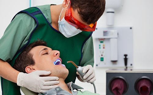 Dentist treating a patient at a dental clinic in Jacksonville, AR