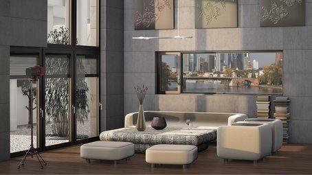 salotto con divano letto e vista su dei grattacieli