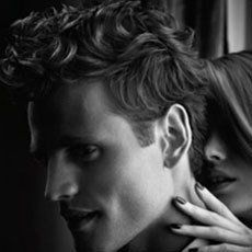 male model's head with woman behind