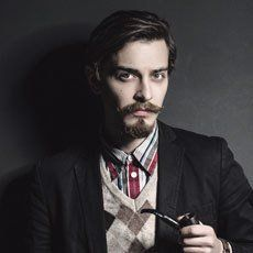 young male model with fashioanle moustache and beard