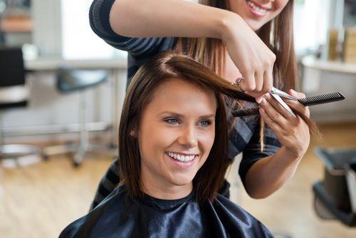 women getting hair cut