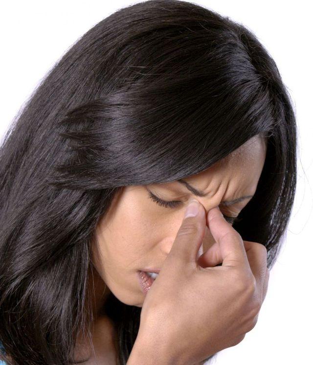 Woman suffering from TMJ in Honolulu, HI