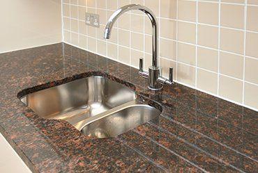 sink on the granite worktop