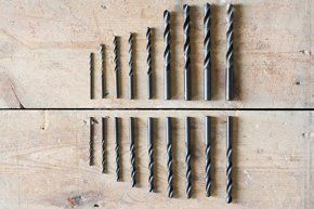 Two rows of drill bits