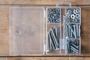 Perspex box full of nuts and screws