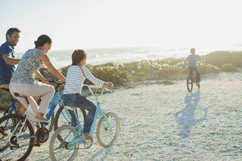 Family of 4 cycling by the coast on mobile home holiday by Todd's Tourers