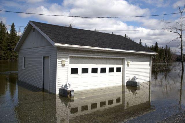 Garage needing a water damage restoration team in Russellville, AR
