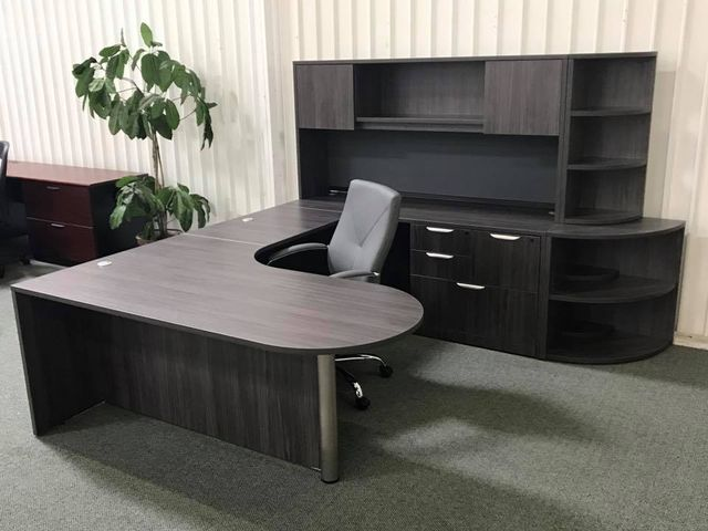 Modern office with large wooden desk and cream chair