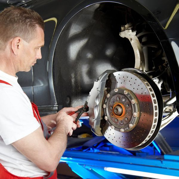 One of our experts performing auto repairs