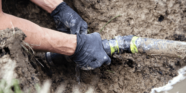 fixing broken drainage pipe