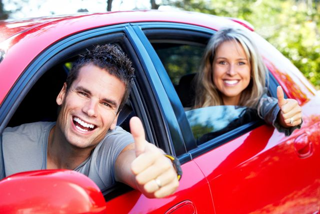 Man and woman driving happy with their car glass replacement in Chillicothe, OH