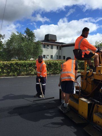 Professional doing the asphalting of road