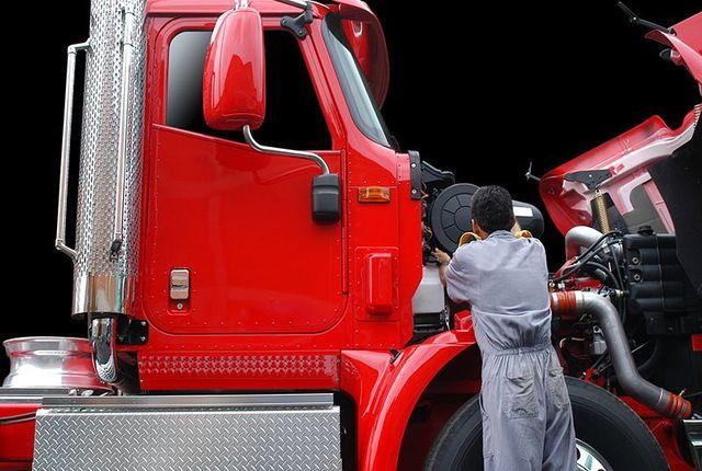 Man repairing truck