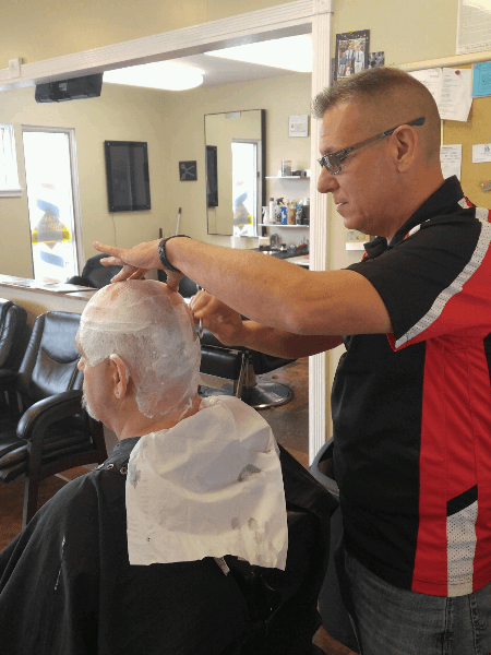 Doug, one of the professional barbers at Olde Milford Barber Shoppe