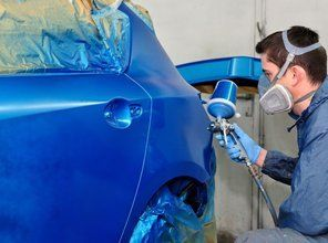 blue car being painted