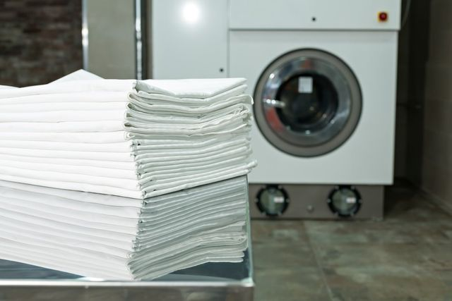 Clean clothes on hangers in the laundry room