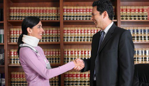 Male solicitor shaking hands with a woman in a neck brace