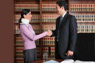 Solicitor shaking hand of woman in a neck brace
