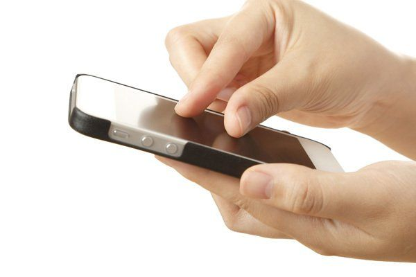 Hand pinching and swiping a smartphone