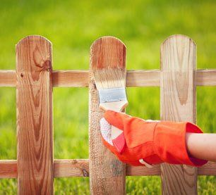 painting the wooden fence