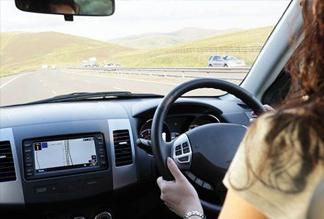 lady driving a car