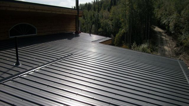 warehouse with metal roofs constructed by quality roofing company in North Pole, AK