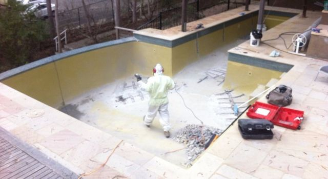 Concrete being renovated on by professional resurfacing technician
