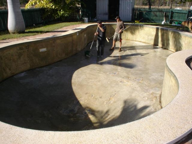 Professional working on the resurfacing of the pool
