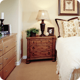 A bedside cabinet and chest of drawers