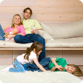 A family relaxing, enjoying their new soft carpet