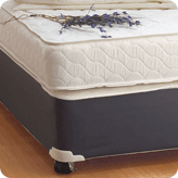 A new mattress on a divan bed