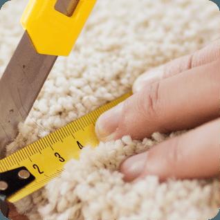 Someone trimming carpet