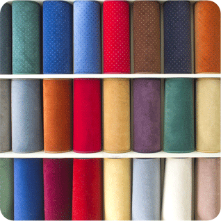 Rolls of carpet in different colours