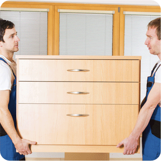 Two workmen carrying a chest of drawers