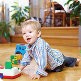 A child playing on a wood floor